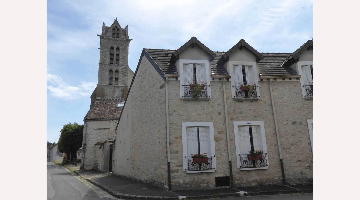 Maison et église à Ury
